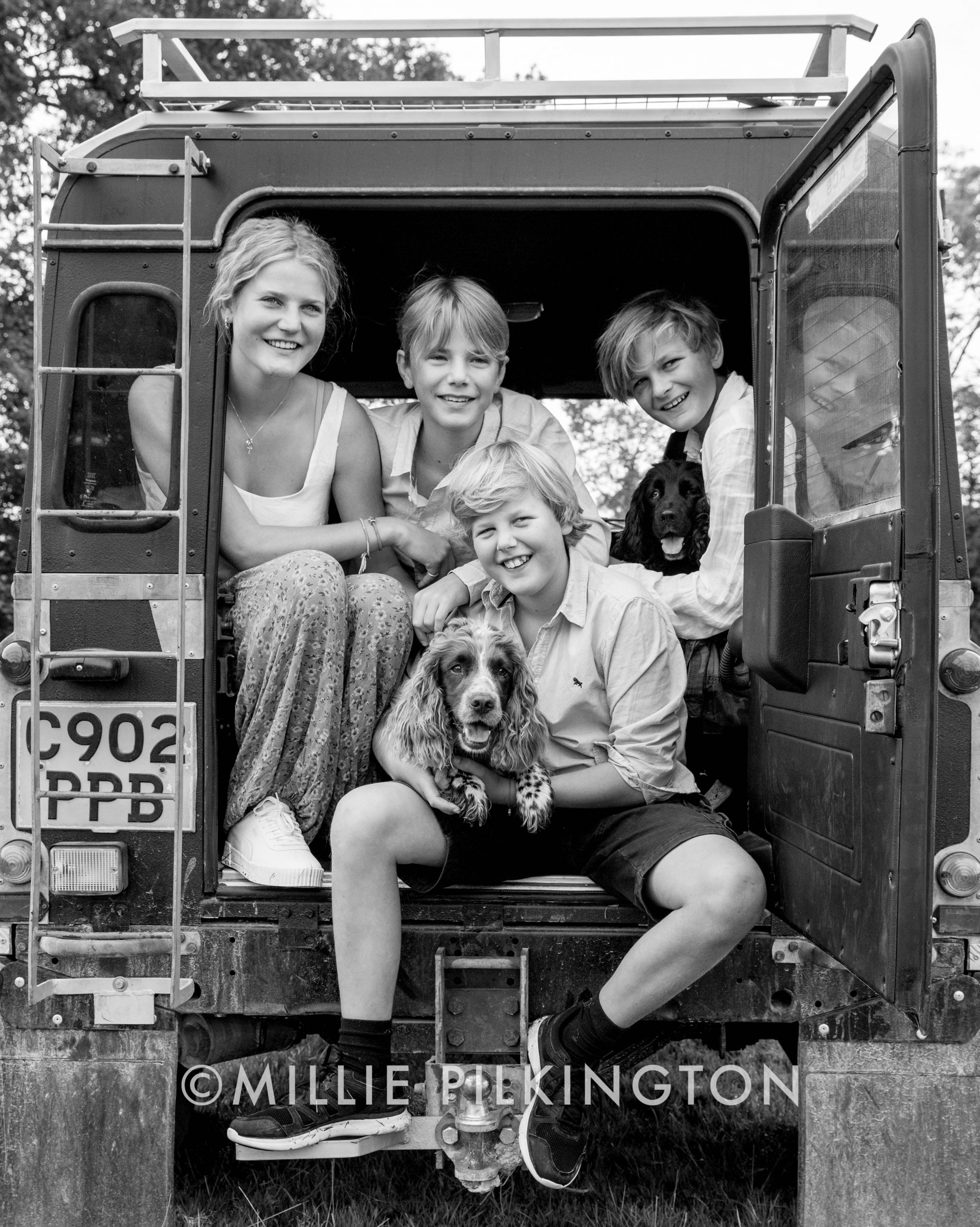 Dorset family photoshoot - siblings in a landrover