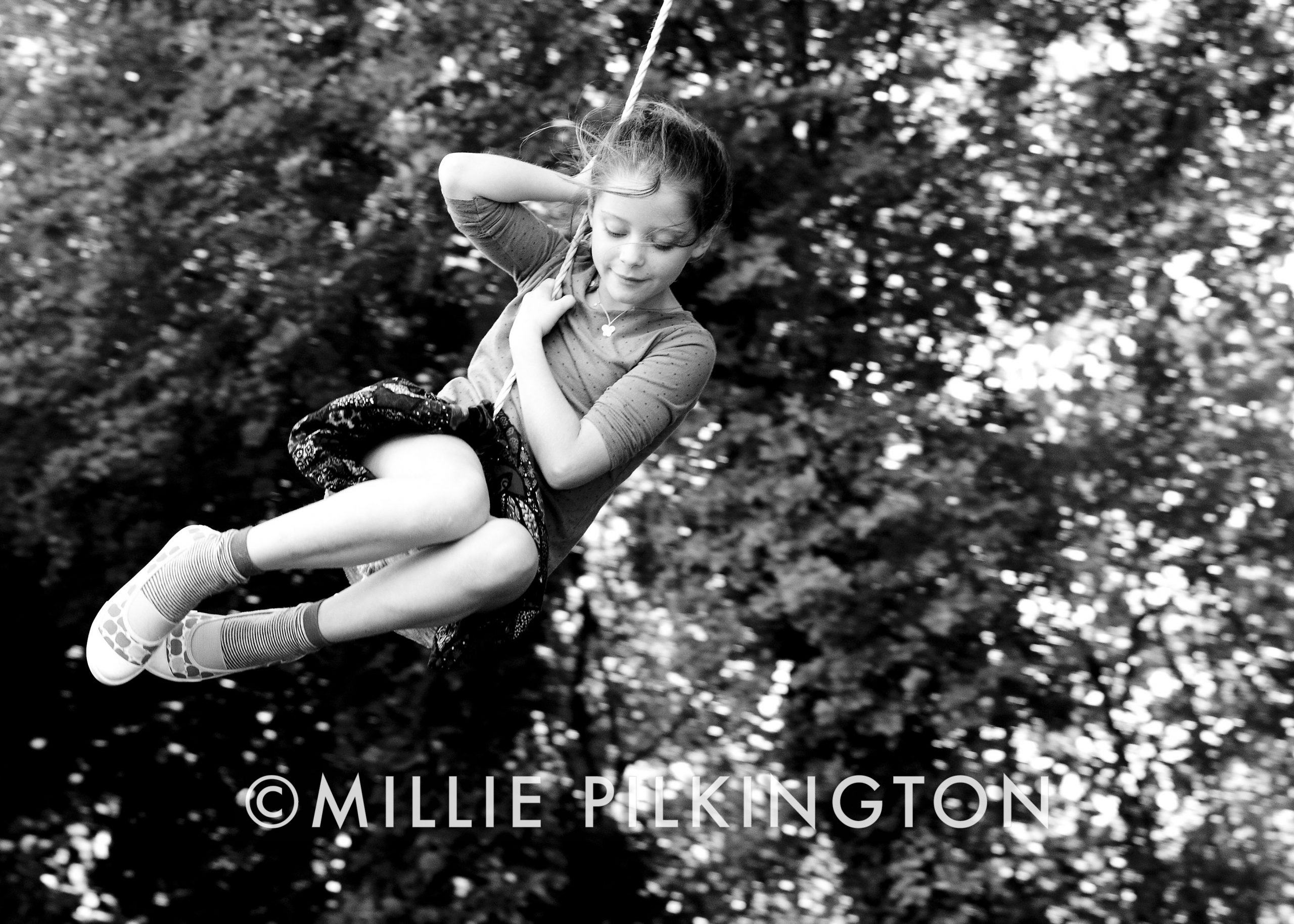 children photography on a swing